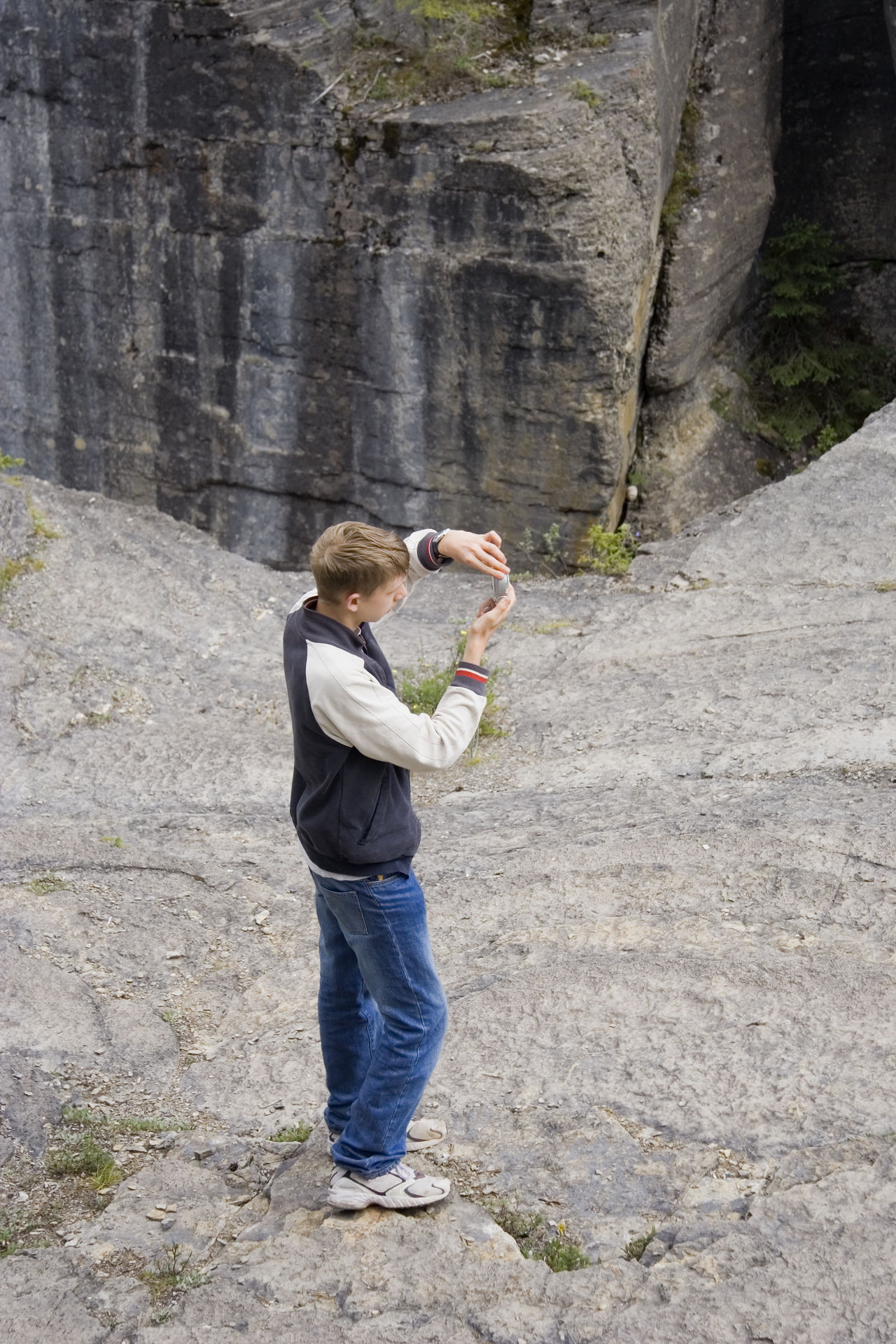 teen taking photos - banff national park, canada Banff National Park  Boy Camera Canada Cliff Creativity Digital Camera Education Exploring Full Length High Angle View Hobbies Holding Mountain One Boy Only One Teenage Boy Only Photographer Real People Rock Standing Taking Photos Taking Pictures Teen Teenage Boy Teenager