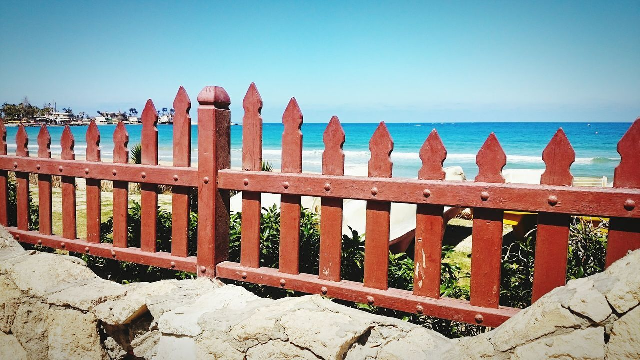 Fence Sky Picket Fence Protection Sunlight Outdoors Beach Clear Sky Horizon Over Water Sea Day No People Summer Alexandria Egypt Alexandria, Egypt Sunlight Nature Maamoura