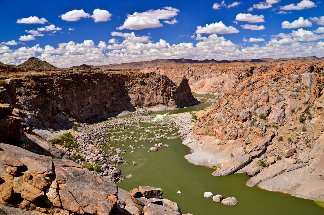 Beauty In Nature Blue Cloud Desert Geology Gorge Hiking Hiking Adventures Landscape Mountain Namibia Nature Orange River Outdoors Physical Geography Rock Rock Formation Schlucht Sky South Africa Southafrica Südafrika Travel Destinations Water Wüste