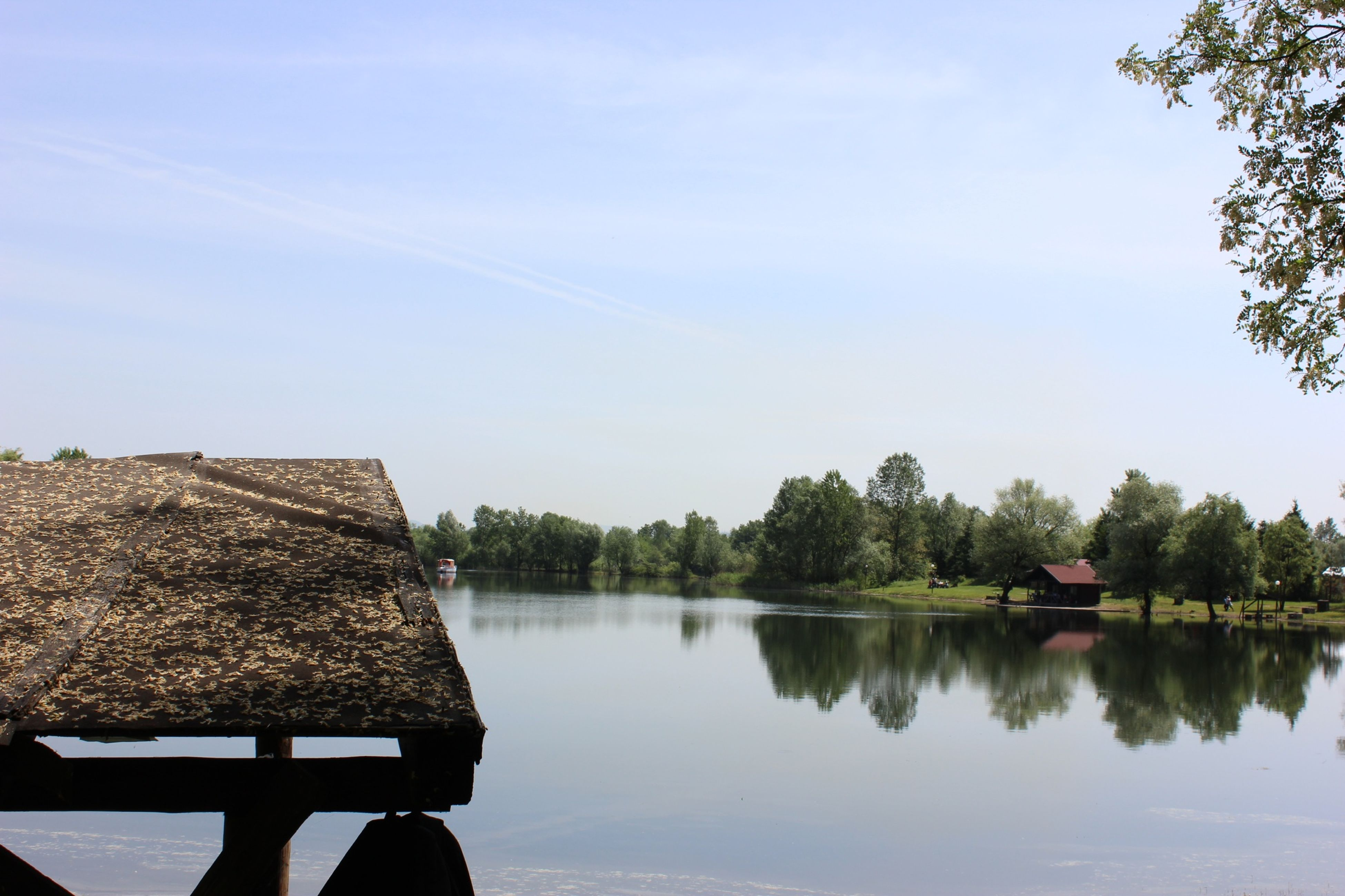 water, reflection, lake, tranquility, tree, tranquil scene, scenics, beauty in nature, nature, sky, idyllic, calm, standing water, lakeshore, clear sky, outdoors, river, non-urban scene