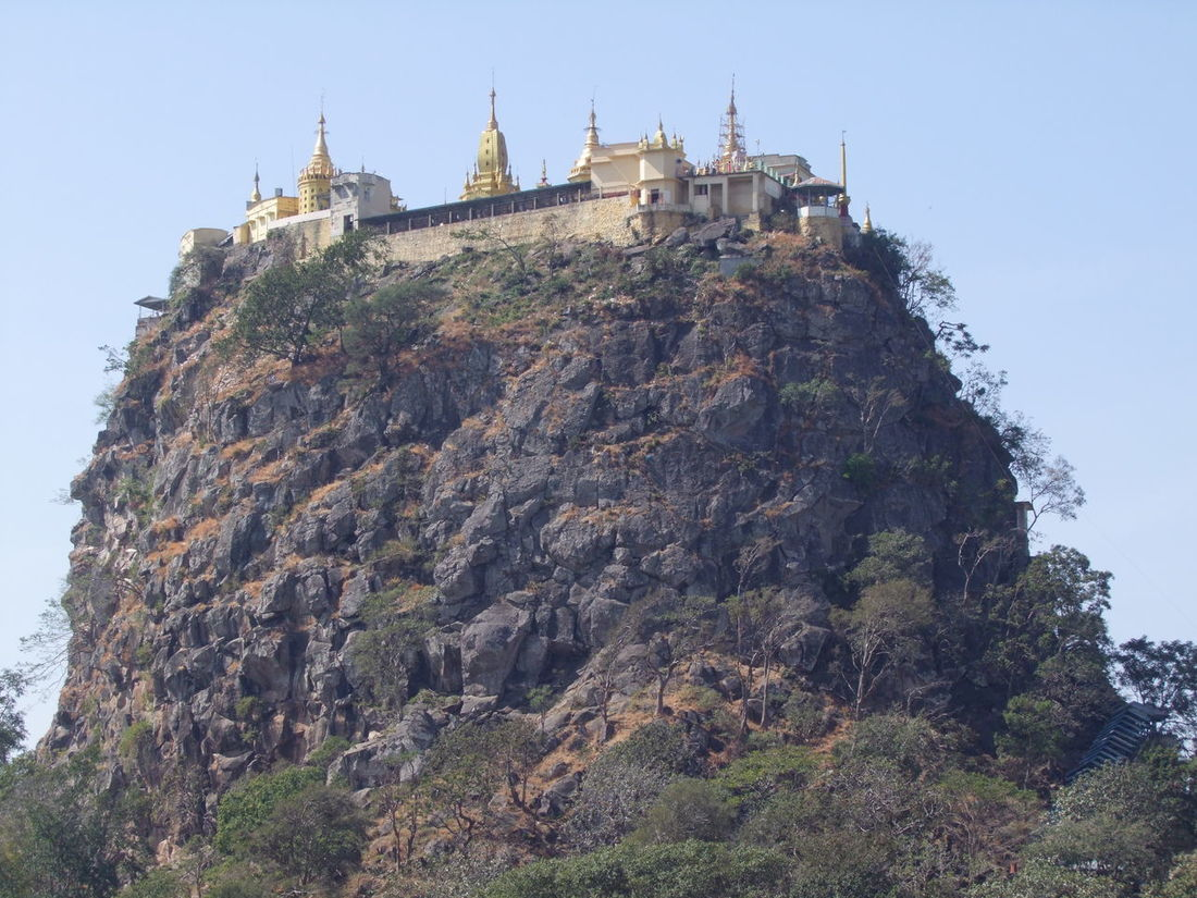 Close up of Mount Popa (4981 ft) Blue Sky Buddhist Pagoda Buddhist Temple Cliff Close Up Composition Famous Place High Up History Low Angle View Mount Popa Mountain Myanmar No People Outdoor Photography Place Of Pilgrimage Place Of Prayer Place Of Worship Place Of Worship Religion Rock Spirituality Tourist Attraction  Travel Destination Trees