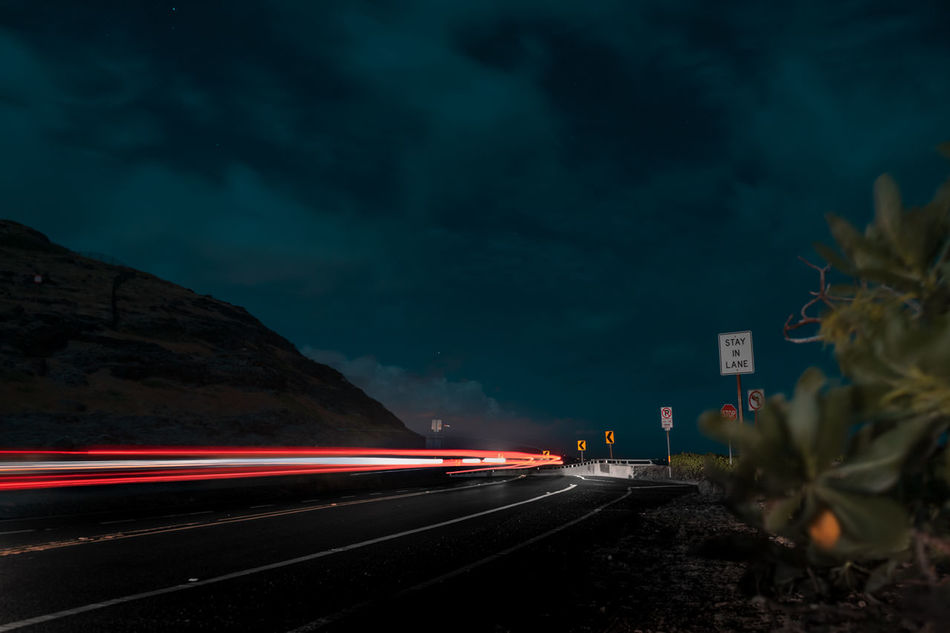 Blurred Motion Car Driving High Street Illuminated Light Trail Lightbeam Long Exposure Motion Mountain Moving Nature Night Nightphotography No People Outdoors Road Skies And Clouds Sky Speed Transportation