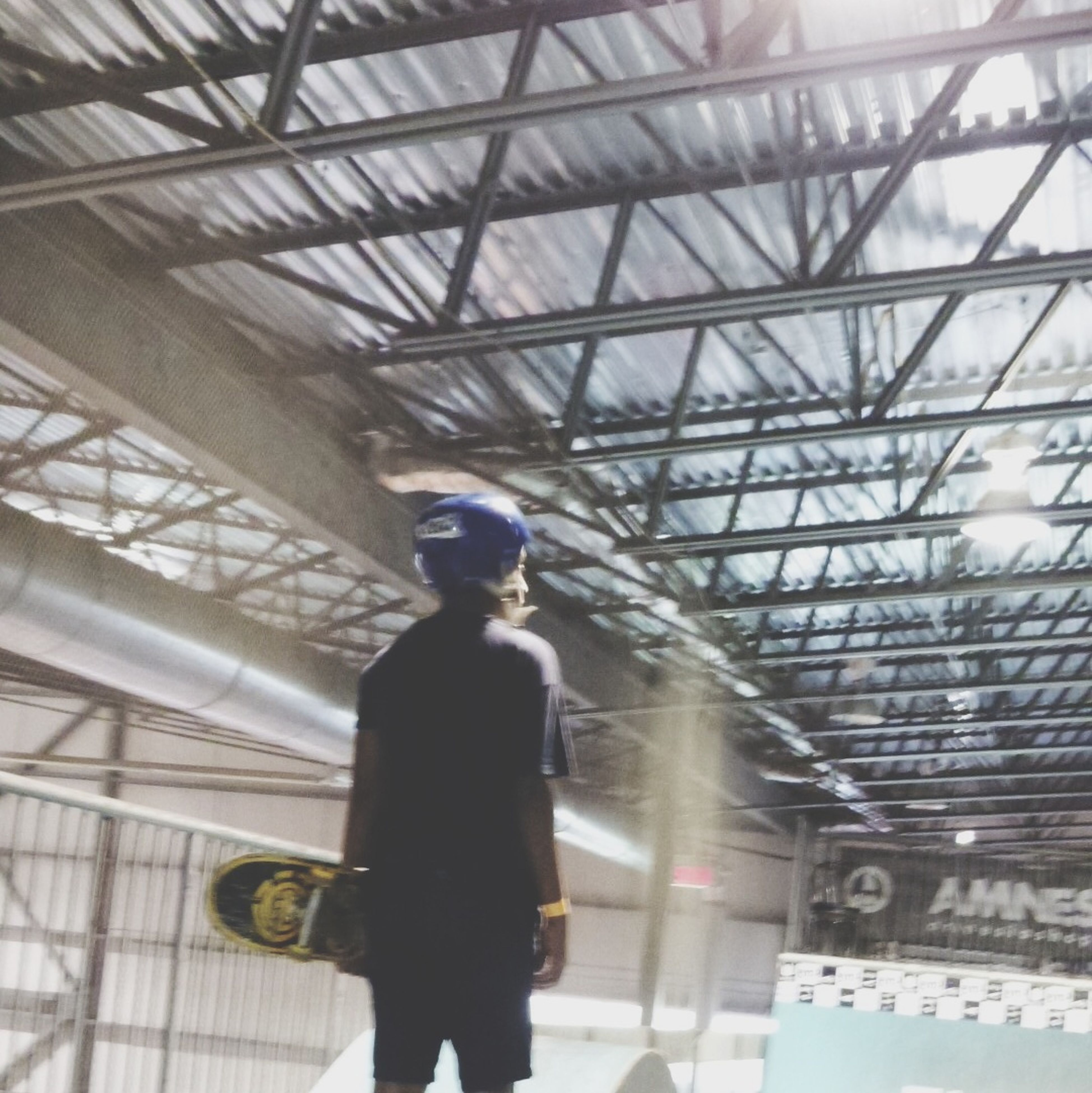 indoors, lifestyles, low angle view, leisure activity, men, built structure, architecture, ceiling, standing, full length, person, casual clothing, travel, young adult, day, modern, famous place