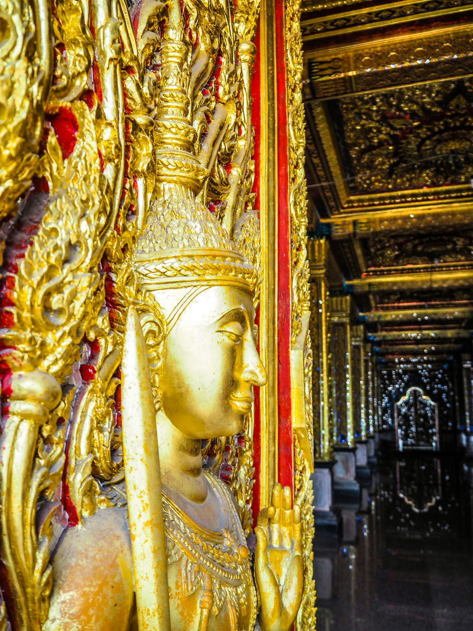 gold colored, religion, spirituality, statue, place of worship, sculpture, gold, human representation, male likeness, art and craft, golden color, golden, idol, no people, travel destinations, day, indoors