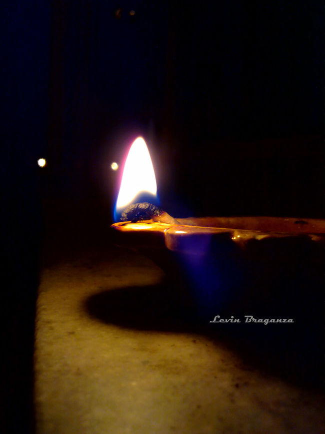 A simple oil based earthen lamp, lit up on the eve of the Indian festival of Deepawali
