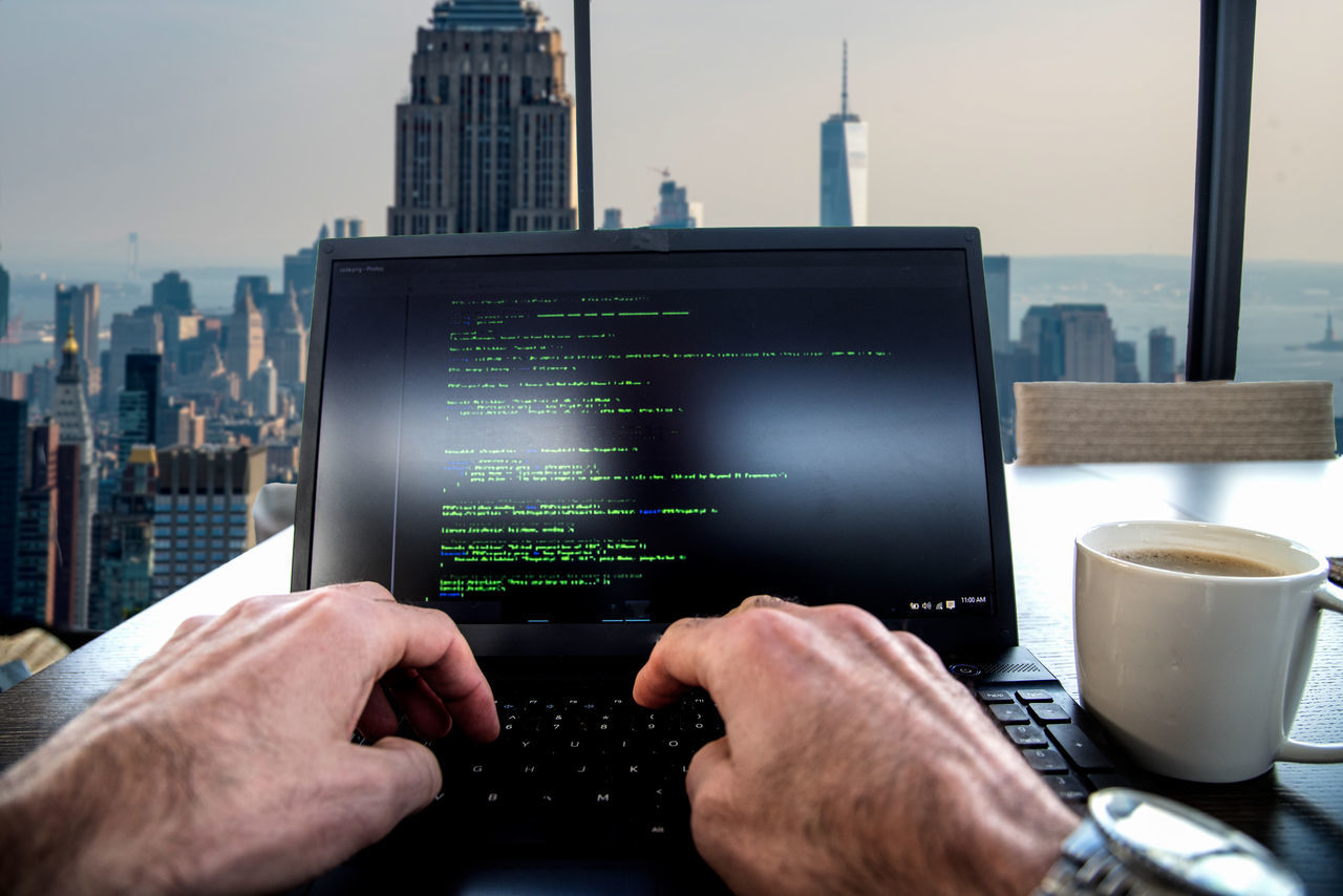 High Rise Coding Adult Architecture Business Finance And Industry City Coding Coffee Day Executive  Finance Horizontal Human Body Part Investing Men One Man Only One Person People Person Politics Sky Skyscraper Technology Trump Urban Skyline Working