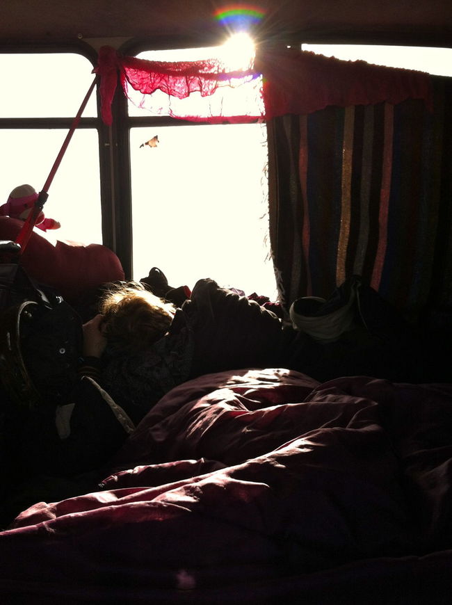 Backlit Blankets Dreaming Light Naptime Rainbow Real People Red Color Softness Sunlight And Shadow Tourbus