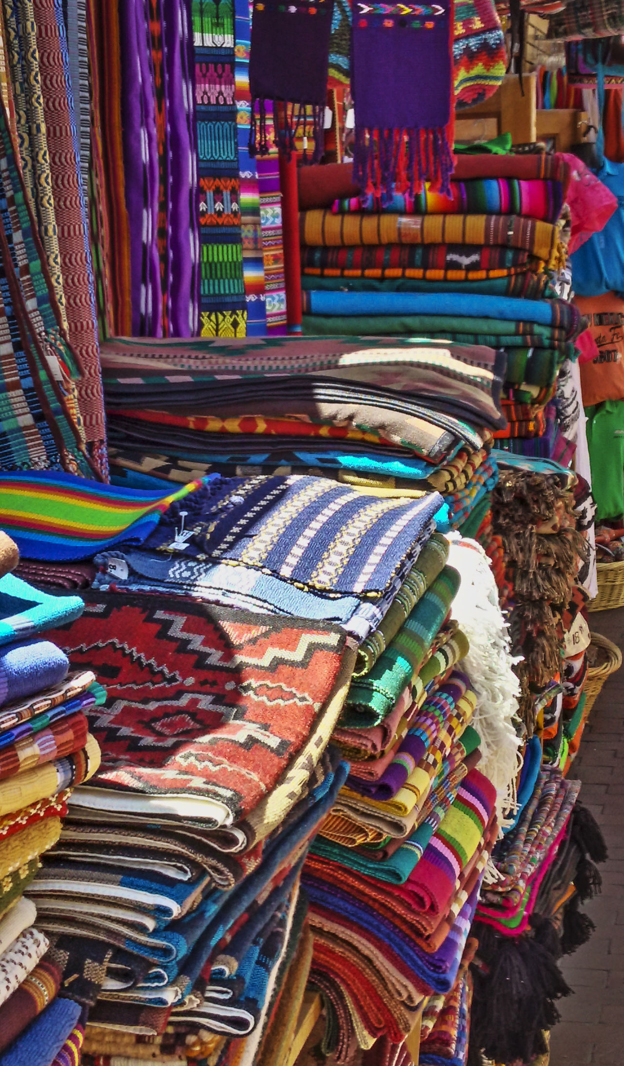 Sante Fe wares. Color and lines. We enjoyed visiting all the shops, and this photo captures the rich and vivid culture. Sante Fe New Mexico Shopping Store Tourism Tourist Sight Seeing Traveling Travel Mexico Pueblo Shop Keeper Blankets Beautiful Colorful Rich Colors Popular Culture Shopping ♡ Vendor Street Market Fabric Fashion Texture Lines