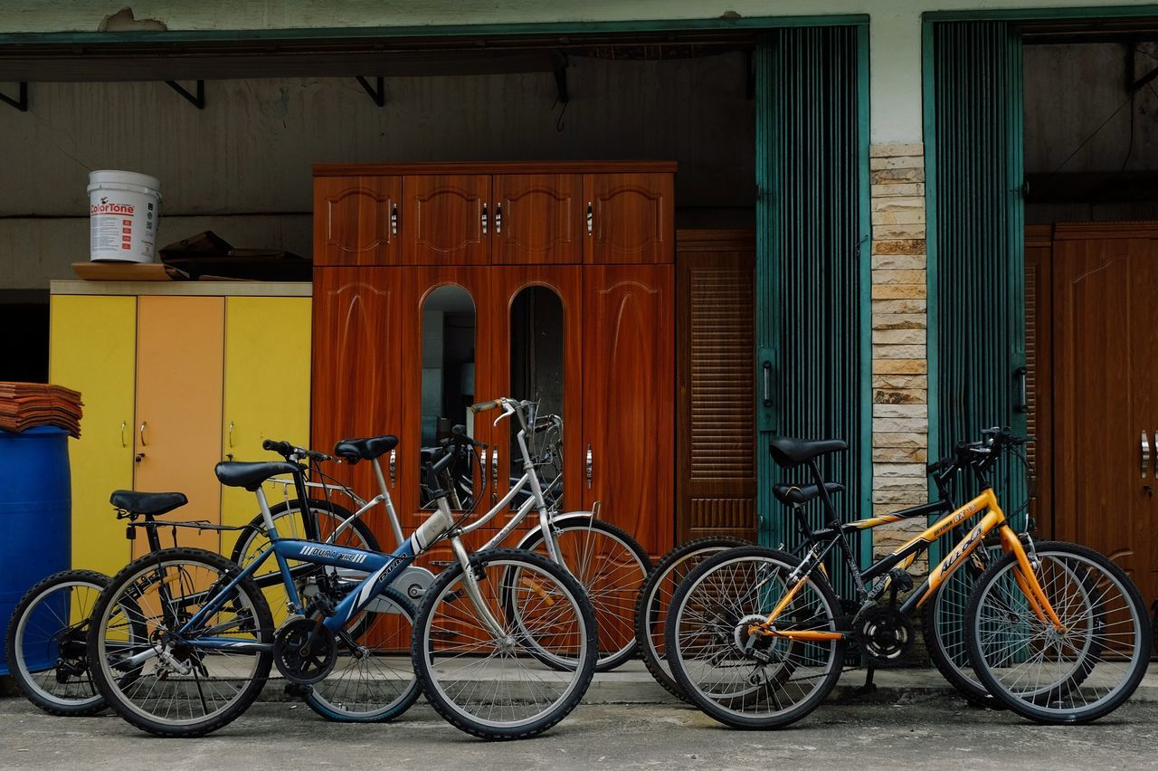 bicycle, transportation, mode of transport, land vehicle, stationary, architecture, no people, built structure, day, outdoors, red, building exterior, bicycle rack