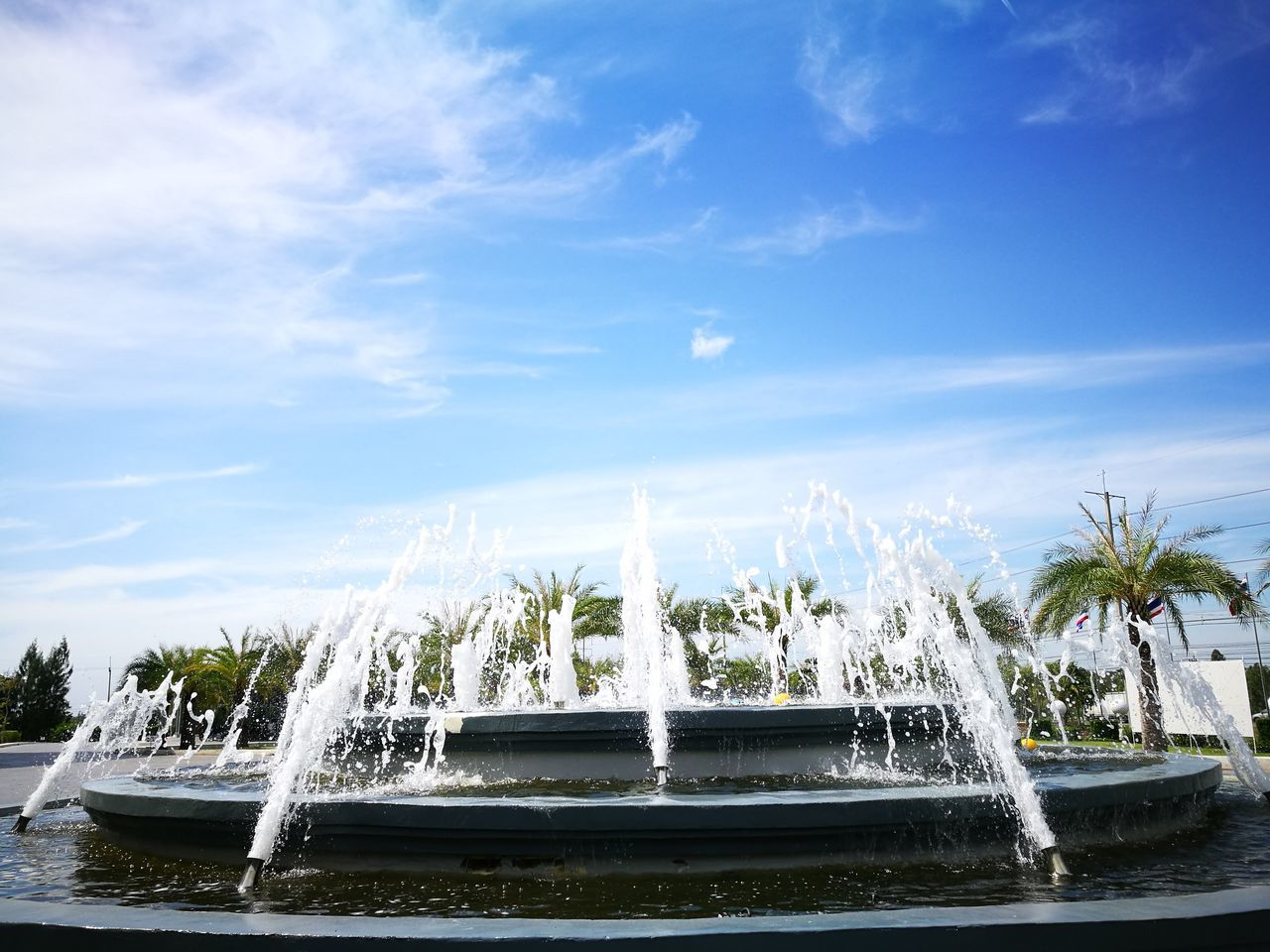 water, motion, fountain, sky, nature, splashing, waterfront, long exposure, beauty in nature, no people, outdoors, day, spraying, cloud - sky, scenics, tree