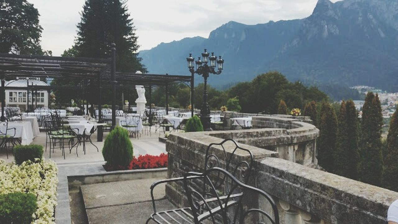 Old romanian restaurant terrace with mountain view Tree Outdoors Water Bicycle Mountain No People Summer Travel Destinations Vacations Nature Day Beauty Tree Area Sky First Eyeem Photo