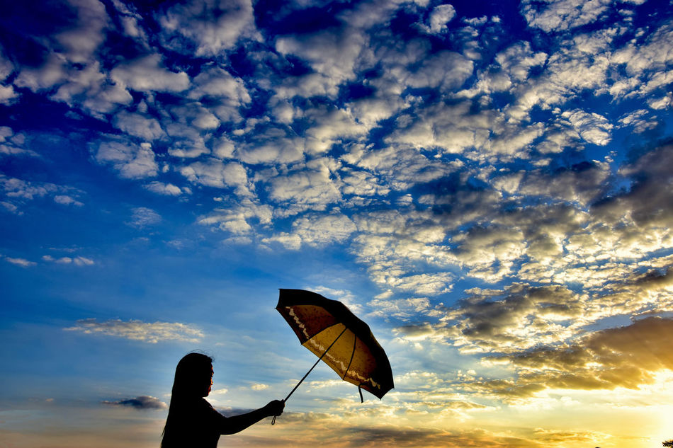 holding an umbrella Close-up Clouds Clouds And Sky Dramatic Sky Girl Lady With Umbrella Nature Outdoors Outdoors Photograpghy  Sky Sunset Twilight Twilight Sky Umbrella Woman