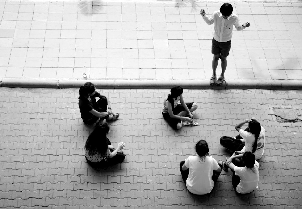 childhood, high angle view, real people, boys, leisure activity, togetherness, medium group of people, girls, full length, indoors, education, day, skill, learning, sports clothing, friendship, lifestyles, standing, exercising, teamwork, people