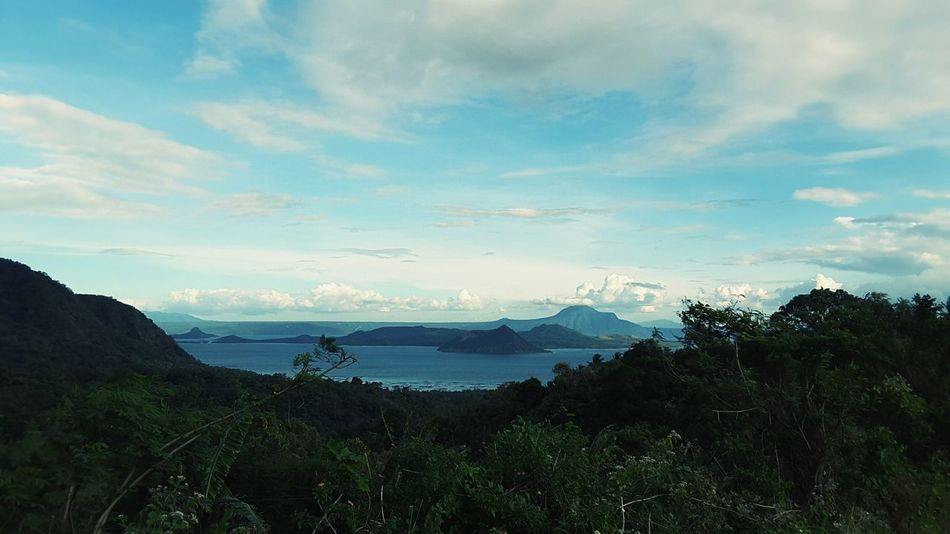 One angle you couldnt see much in taal.Beauty In Nature Travel Destinations Scenics Landscape Idyllic Sea Tree Water Nature Tranquility Mountain No People Outdoors Sky Day