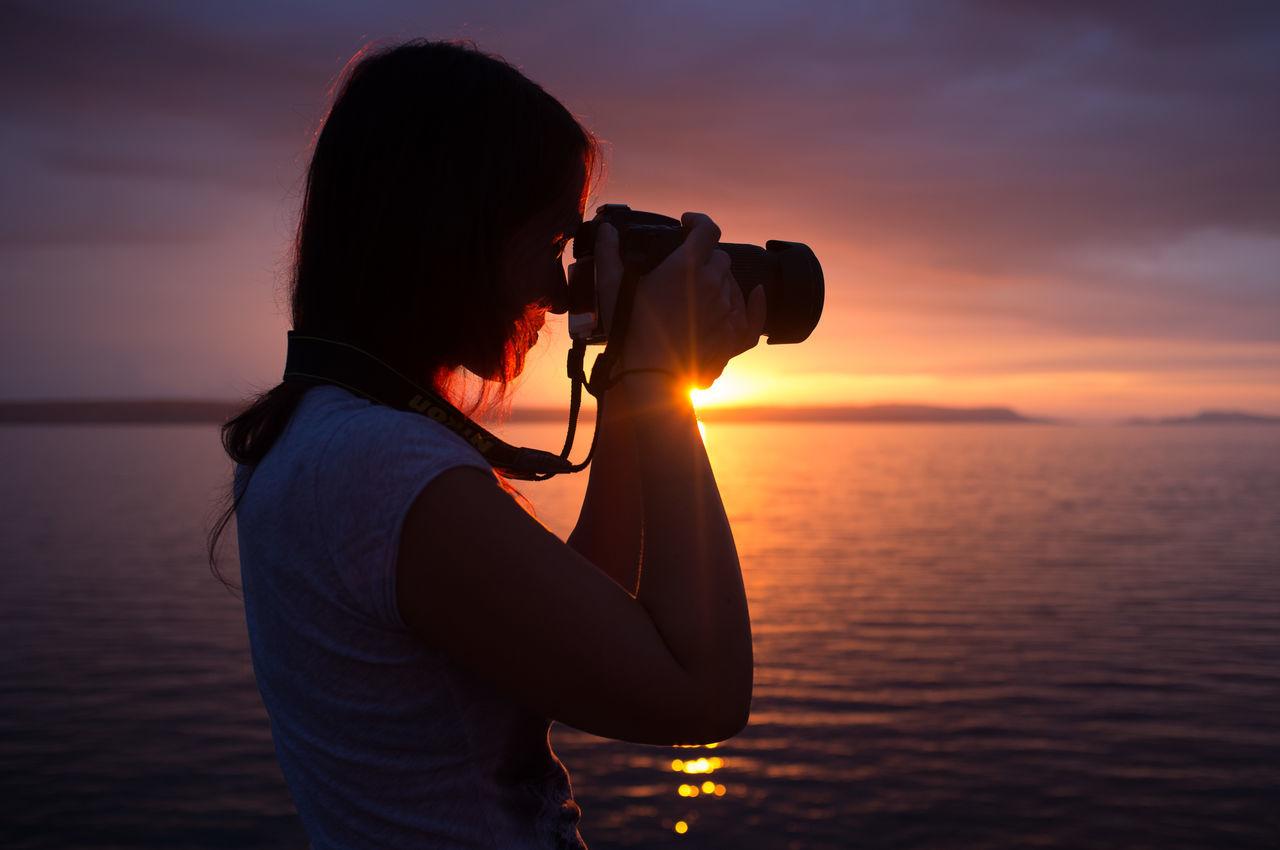 Girl Hobbies Lifestyles Light Photogrpher Real People Standing Sun Sunset Women