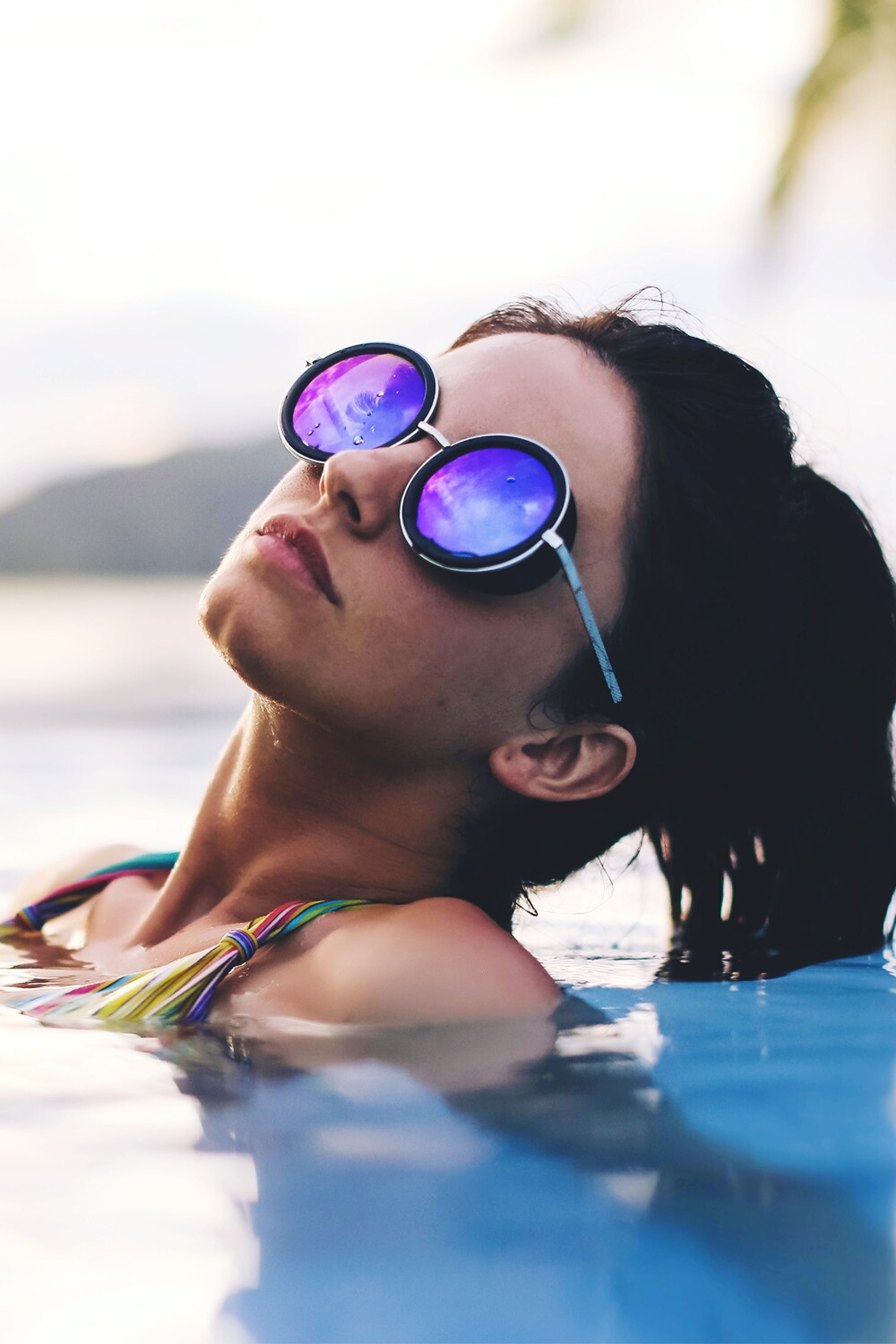 lifestyles, leisure activity, sunglasses, focus on foreground, water, close-up, headshot, childhood, person, reflection, girls, beach, young adult, young women, front view, holding, sunlight