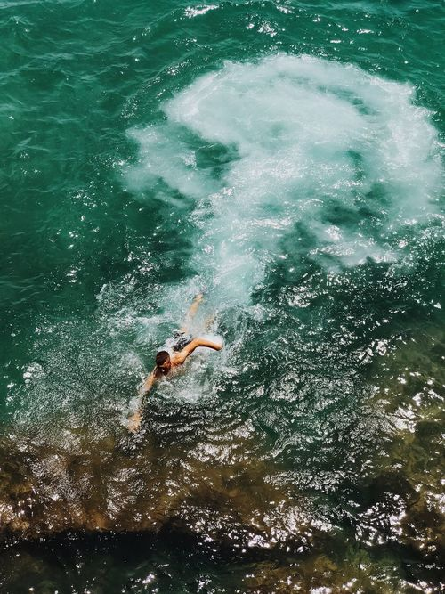 Water Full Length Swimming One Person Real People Sea High Angle View Leisure Activity Jumping Motion Day Waterfront Wave Nature Vacations מייים Adventure Outdoors Shotoniphone7plus IPhone7Plus מייאייפון7 מייעכו The Great Outdoors - 2017 EyeEm Awards Live For The Story Sommergefühle