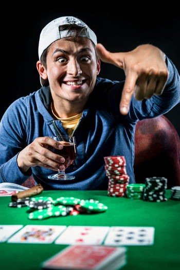 Poker player. Gambling concept Blackjack Casino Gambling Jackpot Man Poker Addiction Cards Casino Entertainment Gambler Gambling Gambling Chip Game Leisure Games Luck Male Player Playing Playing Card Games Poker - Card Game Poker Chips Poker Game Studio Shot Young Adult