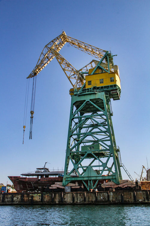Harbour Sevastopol  Architecture Black Sea Blue Building Exterior Built Structure Clear Sky Day Drilling Rig Low Angle View No People Outdoors Port Crane Sea Ship Sky Water