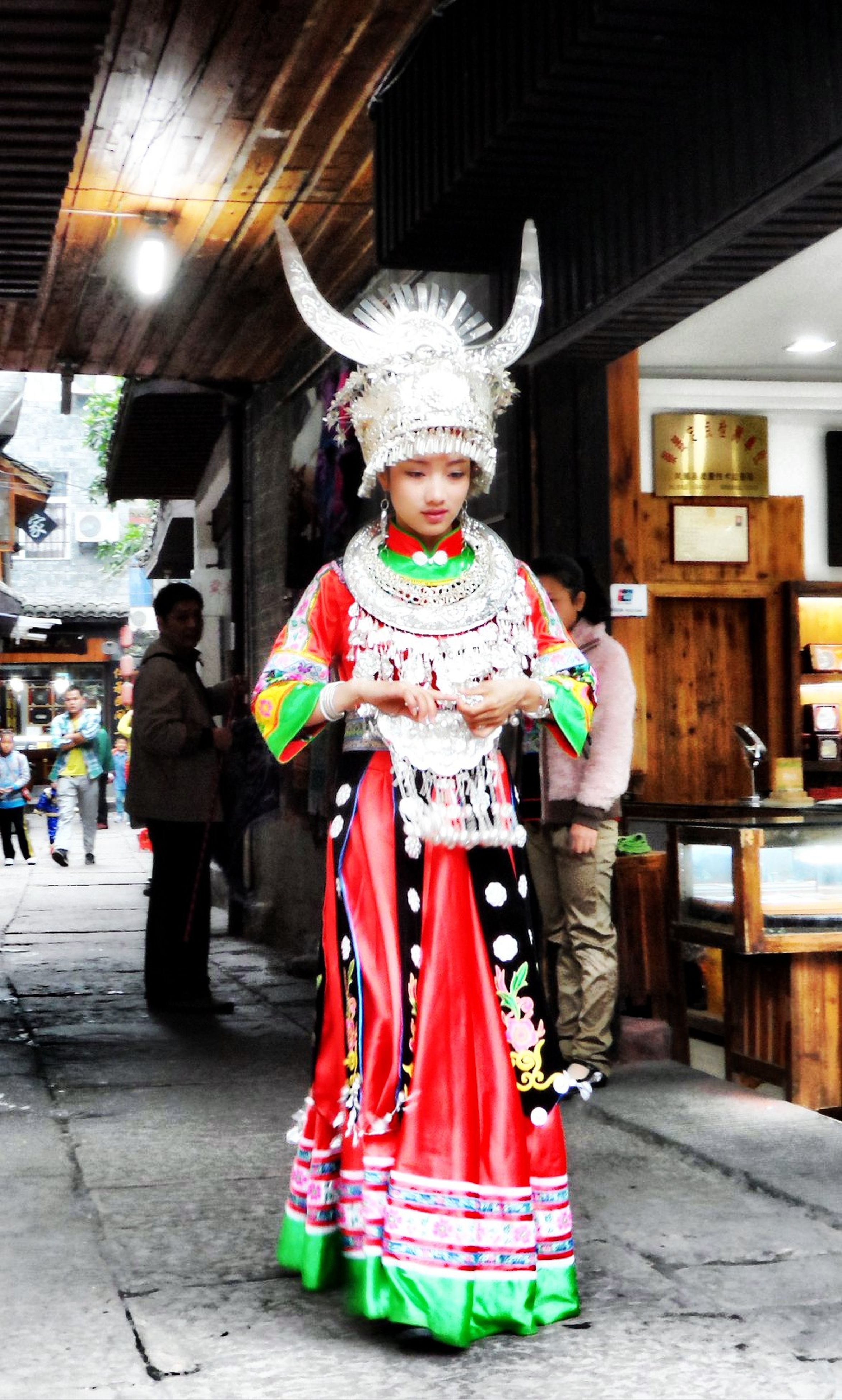 human representation, full length, art, art and craft, statue, casual clothing, lifestyles, front view, creativity, traditional clothing, sculpture, built structure, leisure activity, architecture, standing, costume, building exterior, childhood