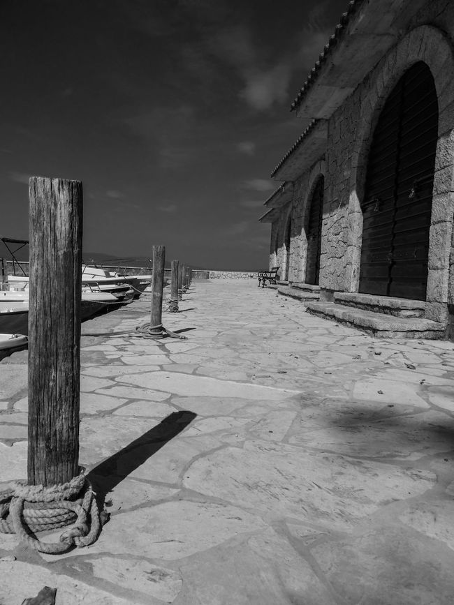 Morning shadow on dock Architecture Black And White Building Exterior Day Depth Of Field Doors No People Outdoors Shadow Shadows & Lights Stone Material Stones Summer Sunlight The Way Forward Wood