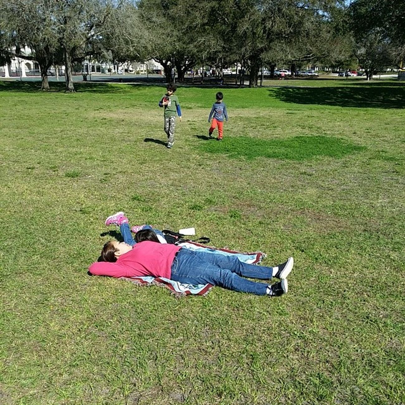 Beautiful day in the park and the ladies think they're at the beach.