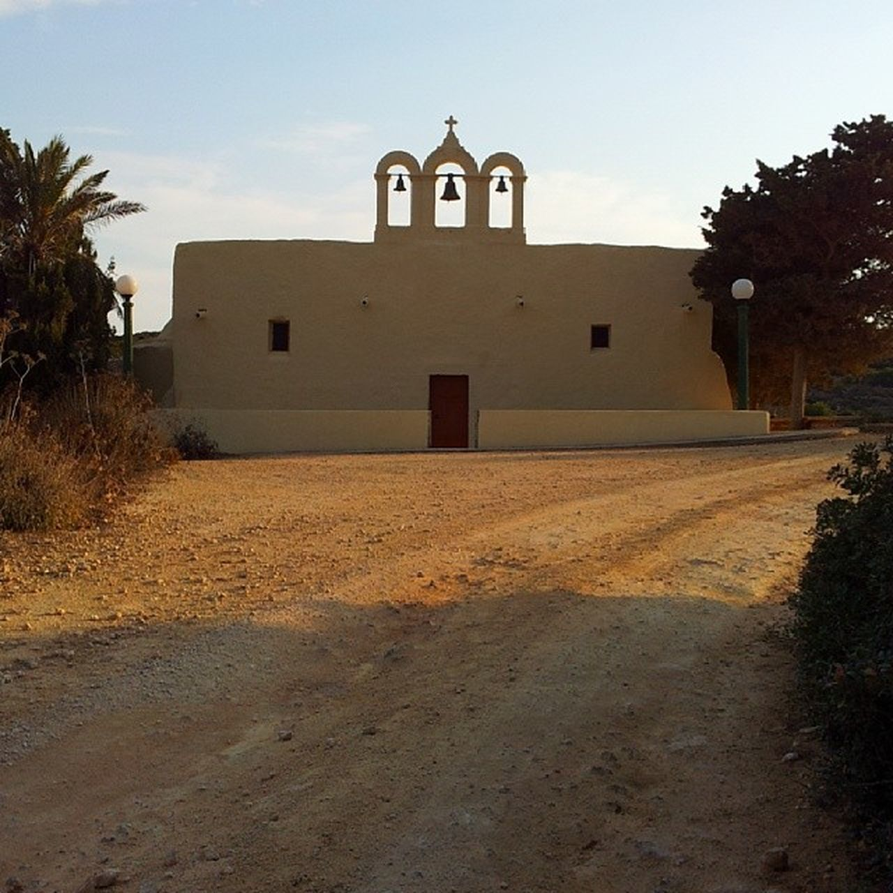 religion, built structure, architecture, spirituality, place of worship, building exterior, cross, no people, sky, day, outdoors