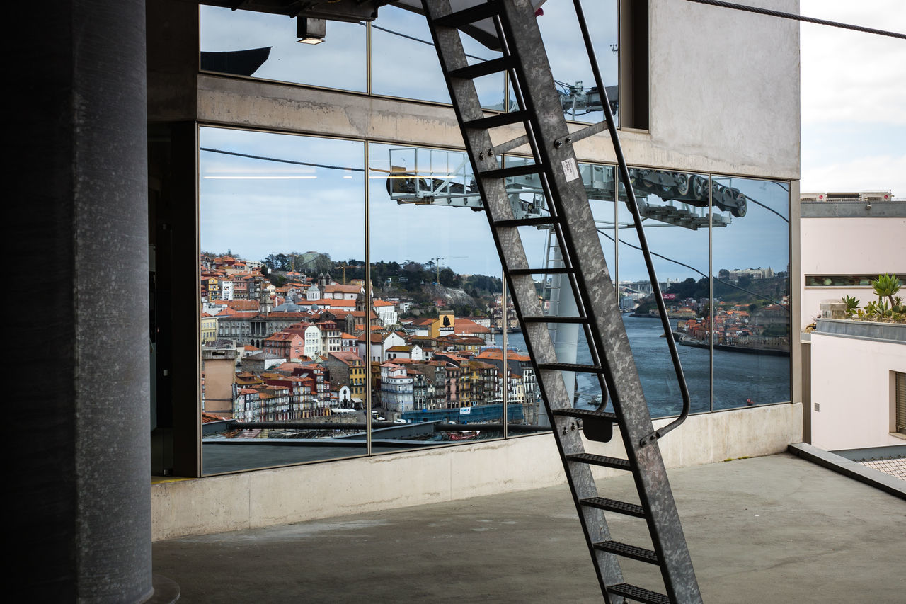 Reflection of the City of Porto in a window, Portugal Architecture Architecture Blue Sky Building Exterior Built Structure Cable Car City City City Scape Day Douro  High Angle View Industry Mirror Nature No People Panorama Porto Portugal Reflection Reflections River Sky Unusual View