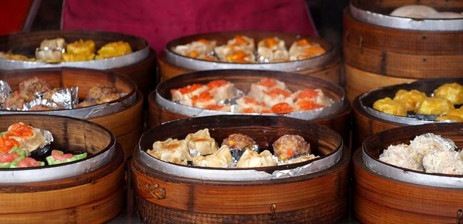 Outdoor vendors sell steamed dimsum dumplings in hot bamboo steamers Bamboo Steamer Cantonese Food Chinese Food Dim Sum Dimsum Food Hot Steam Steamed Dumplings Street Food Stuffed Food Wrapped