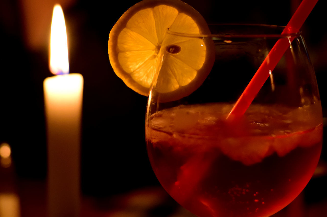 Alcohol Aperol Spritz Aperolspritz Burning Candle Candle Light Candle Lighting  Close-up Cocktail Crushed Ice Drink Flame Food And Drink Freshness Fruit Ice Indoors  Lemon Longdrink No People Red Yellow