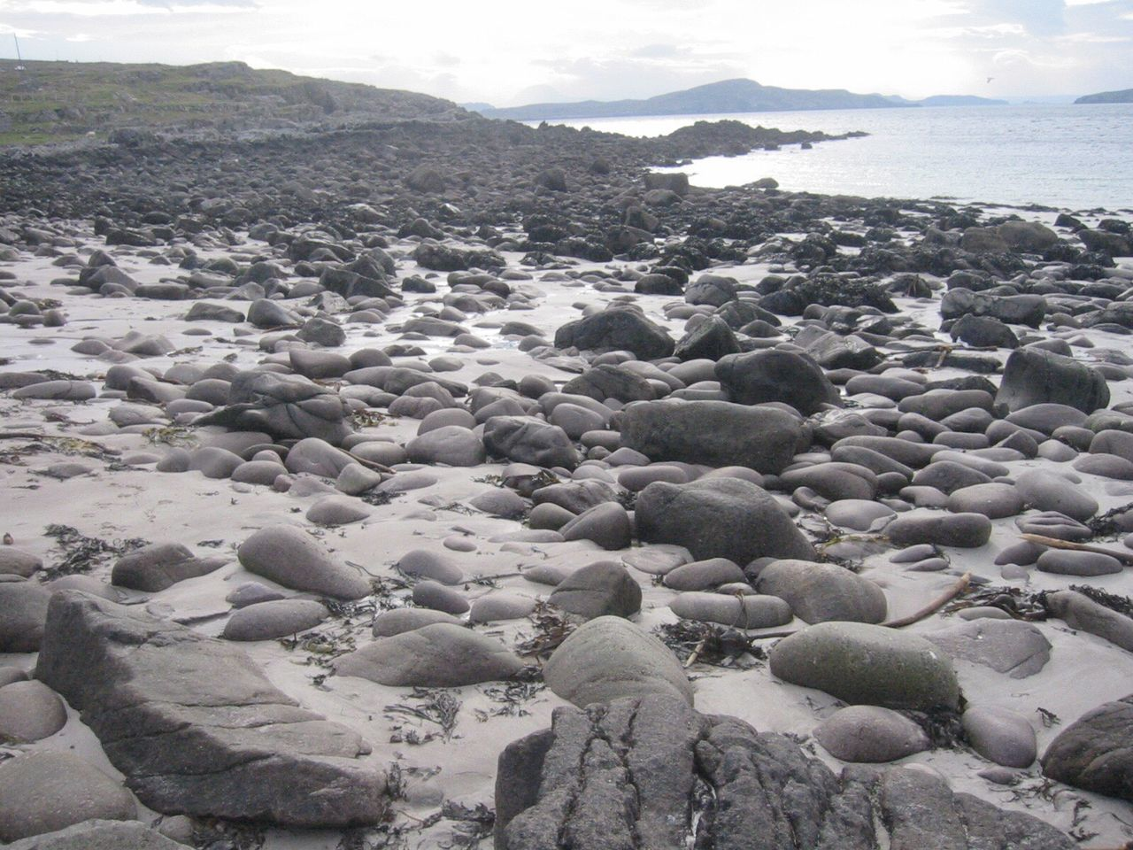 beach, shore, nature, sea, no people, beauty in nature, outdoors, day, pebble beach, tranquility, pebble, water, scenics, sky, close-up