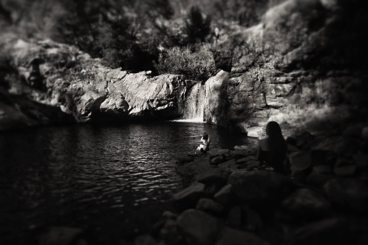 Monochromatic Mood Rock - Object Nature Water Rock Formation Beauty In Nature Real People Adventure Rock Tranquil Scene Sea Full Length Tranquility Day Scenics Outdoors One Person Black & White Waterfall Monochrome Photography California Light And Shadow