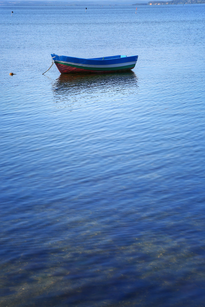 water, waterfront, nautical vessel, nature, outdoors, lake, transportation, day, tranquility, rippled, no people, beauty in nature, blue, moored