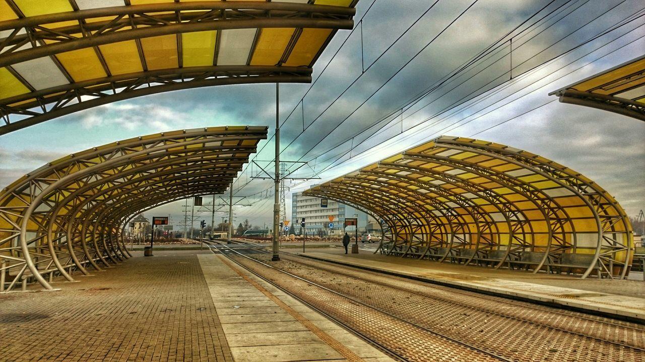 Roof On Railroad Station Platform Against Sky