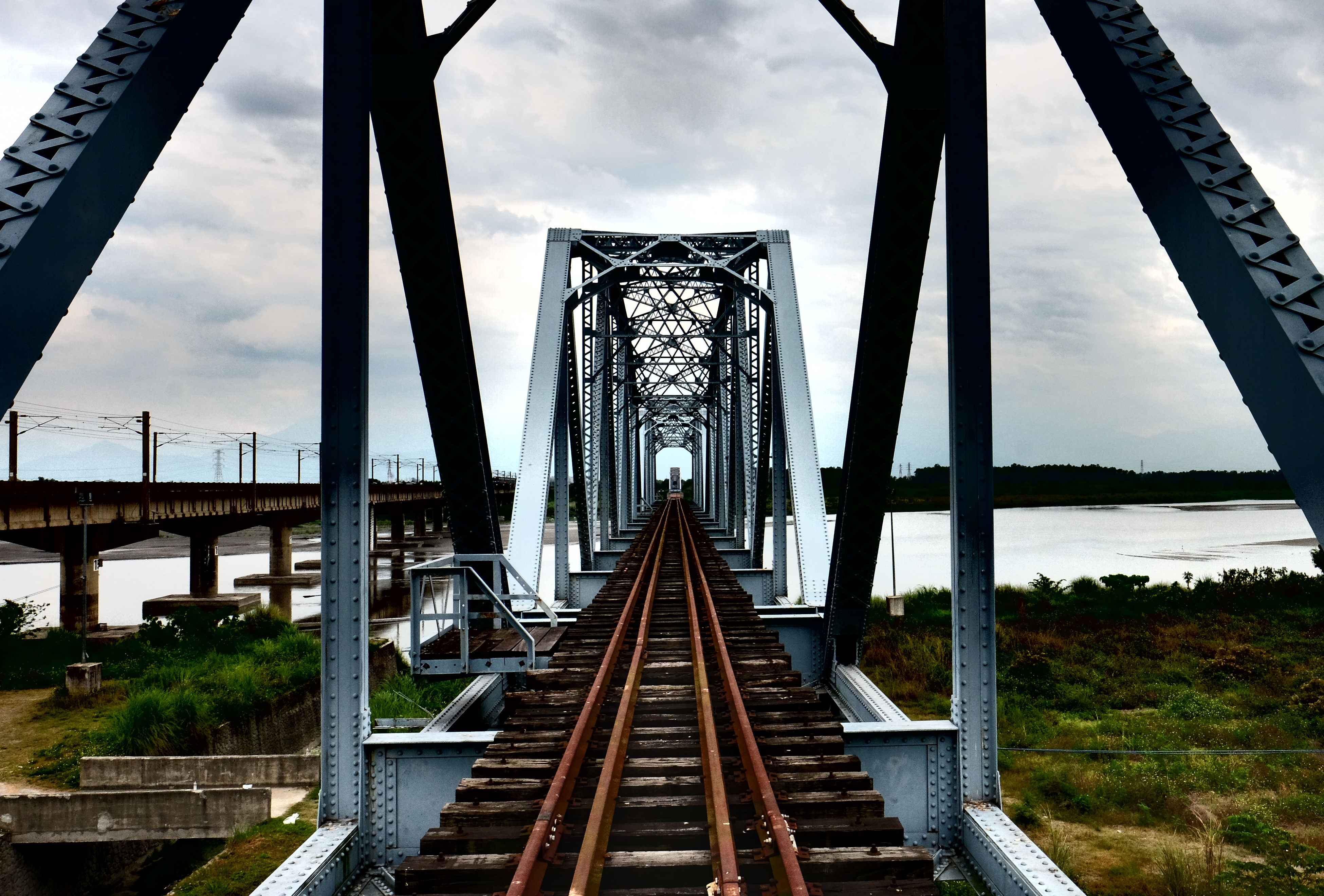 built structure, architecture, connection, bridge - man made structure, sky, engineering, the way forward, diminishing perspective, cloud - sky, vanishing point, cloud, cloudy, metallic, railway bridge, long, travel destinations, outdoors, no people, day, tourism, nature