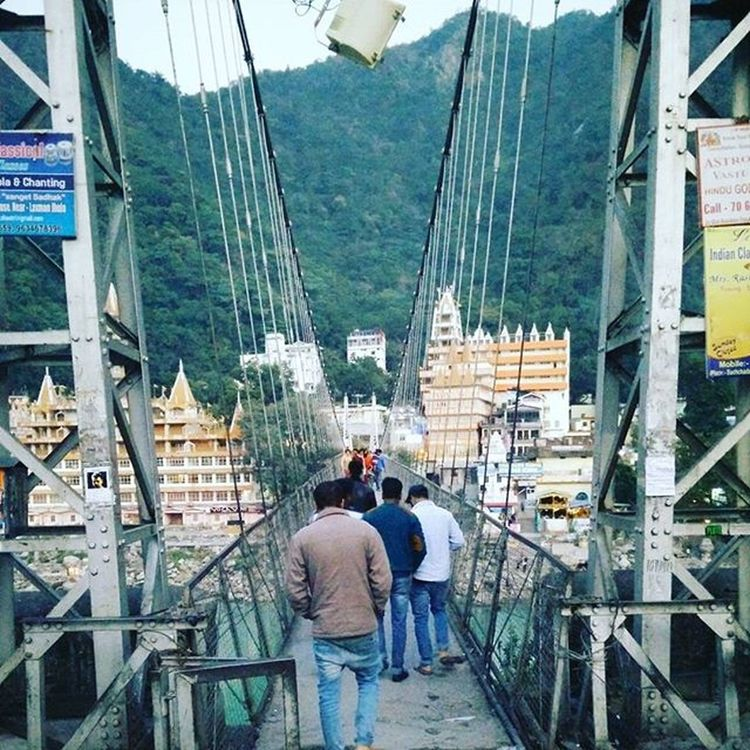 One of the most prestigious and first of it's type jeepable iron suspension bridges in UP, India.. It is said to be built where Lakshman used just jute ropes to cross the Ganges and thus named the Lakshman Jhula.. Civilengineering Suspensionbridge Marvel Journey Rishikeshdiaries Bridges Traveller Ganges Bridge View Travelexperience Traveldiaries Bridgingthegap Crossing Indianheritage Indiadiaries L4l Windycity Old Engineering Structure Crossover Instagram Ironmade amateurphotographer lakshmanjhula uttarakhand madeinindia holycity trip