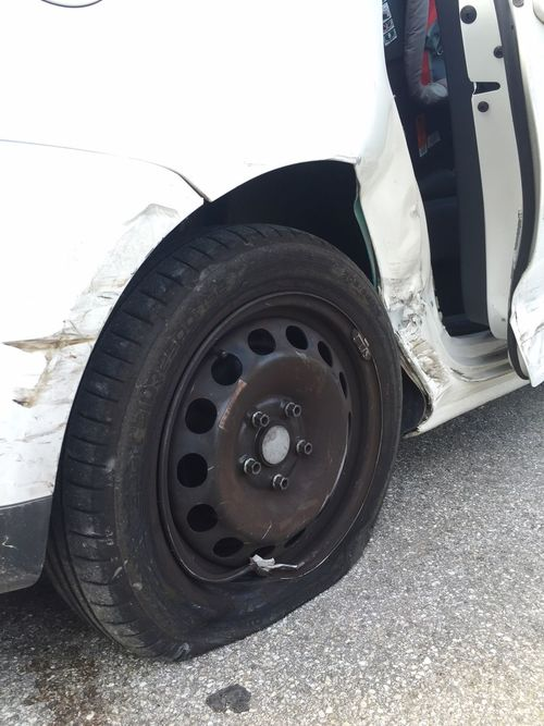 Detail of a demaged car after a traffic accident Tire Wheel Transportation Land Vehicle Car Mode Of Transport Rubber Outdoors No People Close-up Auto Repair Shop Day traffic accident damage white