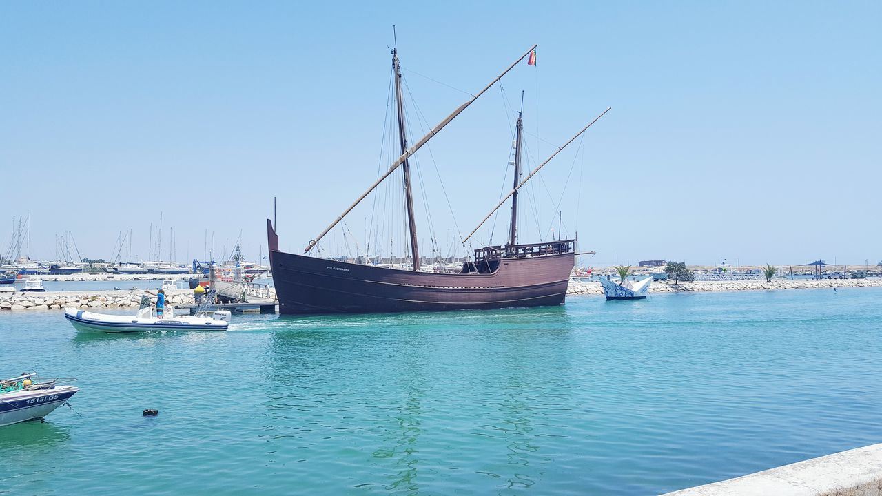 nautical vessel, transportation, moored, mode of transport, water, blue, day, harbor, no people, sea, waterfront, clear sky, outdoors, nature, mast, sky