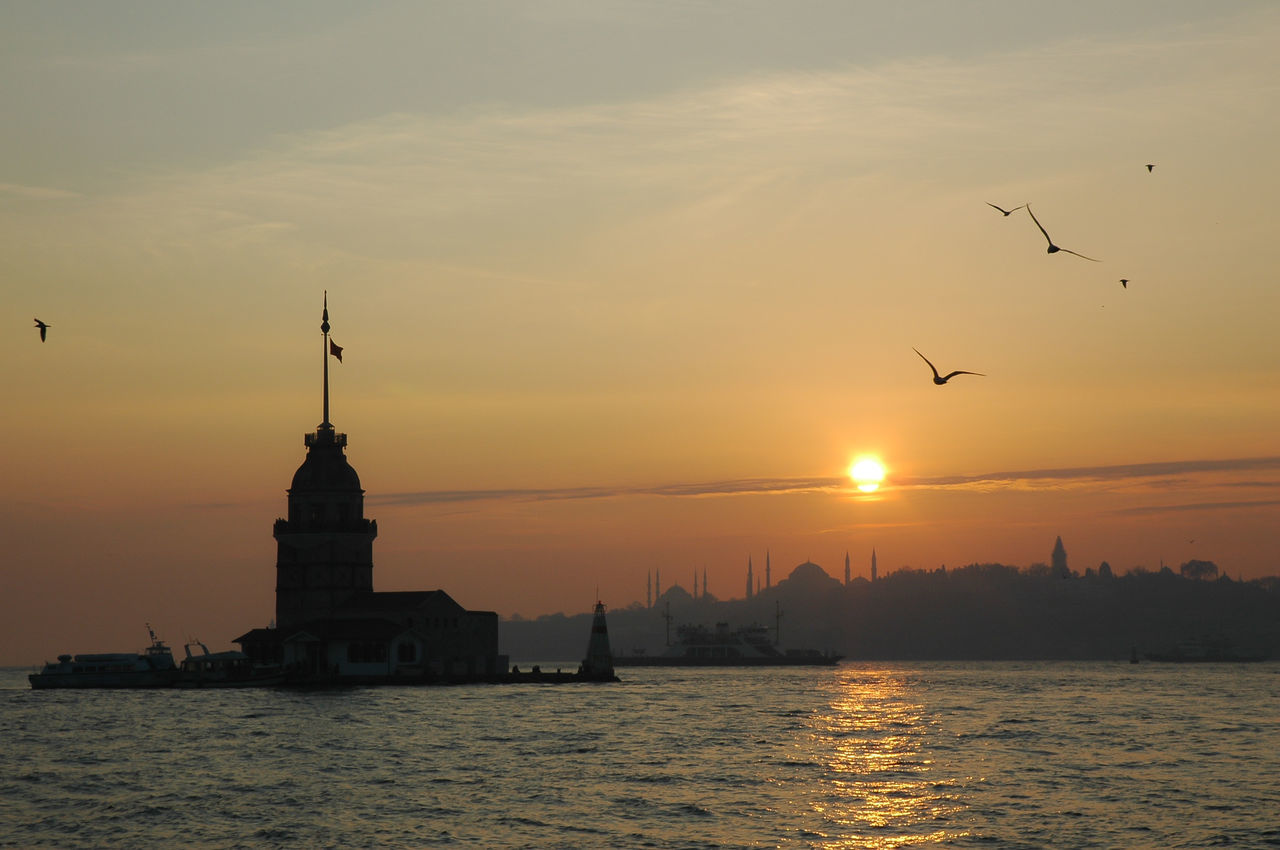 Maiden Tower Architecture Bird Bosphorus Istanbul Kızkulesi Maiden Tower No People Outdoors Reflection Sea Seagull Silhouette Sky Sunset Tranquility Water