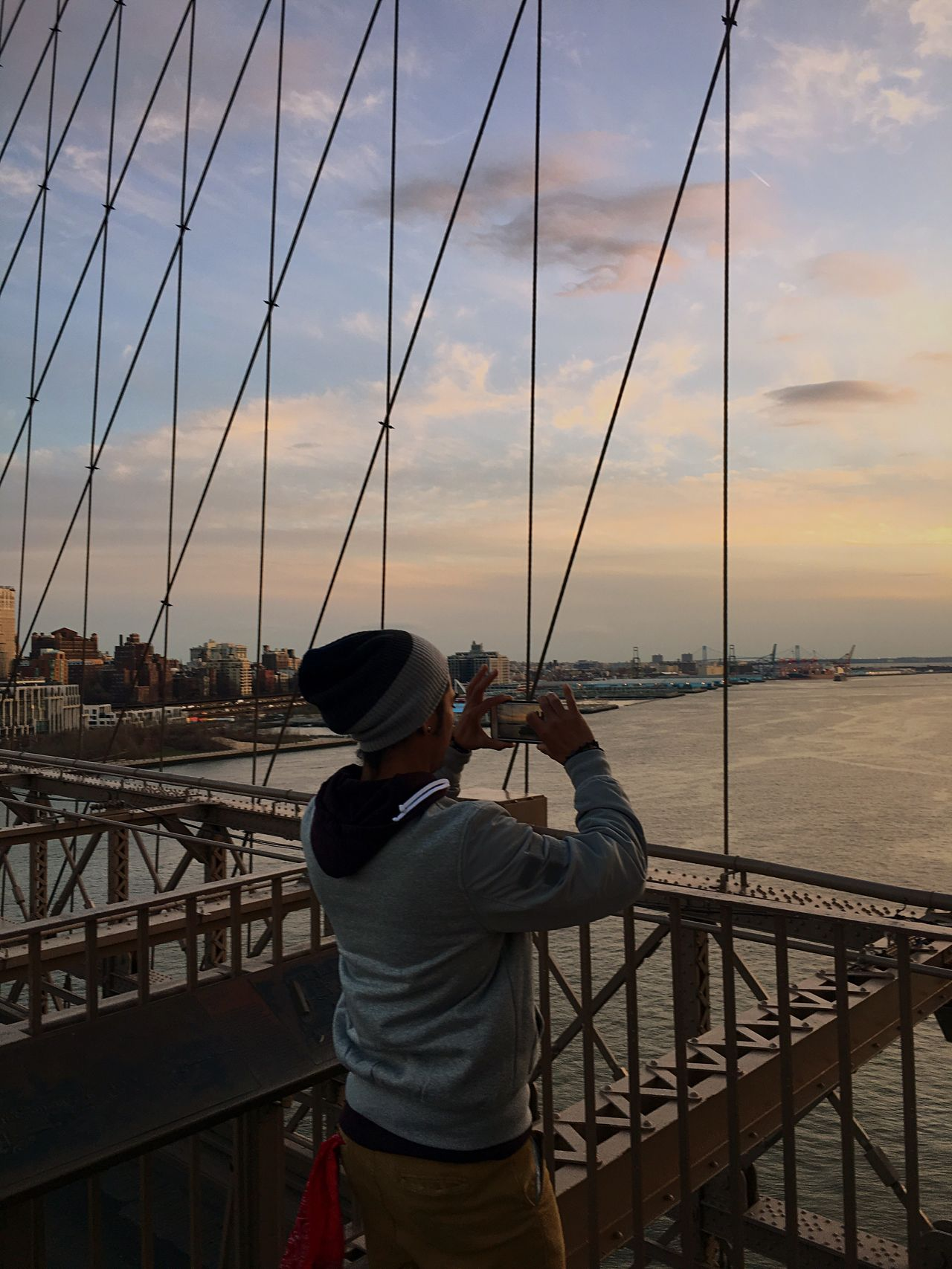 Mobile Conversations Sky Standing Holding Sea Photography Themes Water Railing One Person Men Outdoors Camera - Photographic Equipment Rear View People Adult Adults Only Day One Man Only Fishing Pole