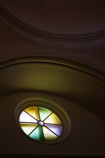 Architectural Feature Atmospheric Church Circle Circular Dark Design Directly Below Geometric Shape Illuminated Low Angle View Monte Del Toro No People Part Of Stained Glass Subtle Light Shades Window Circles