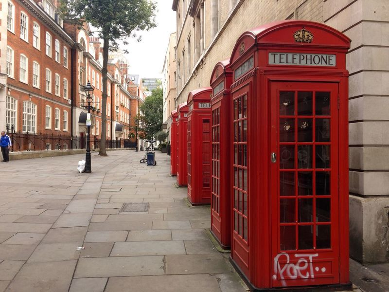 Postcode Postcards London! Red Telephone Booth Architecture Building Exterior Street Built Structure Communication City Outdoors Pay Phone Text City Street Day Telephone Travel Destinations Road No People Police Station Sky