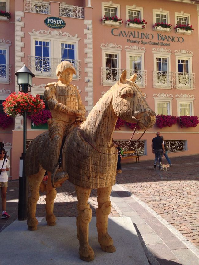 Ortisei Building Exterior Architecture Built Structure City Domestic Animals Full Length Mammal Statue Street Day Outdoors City Life In Front Of Performance Pedestal Livestock Old Town Animal Hair South Tyrol Italy Bolzano Wood