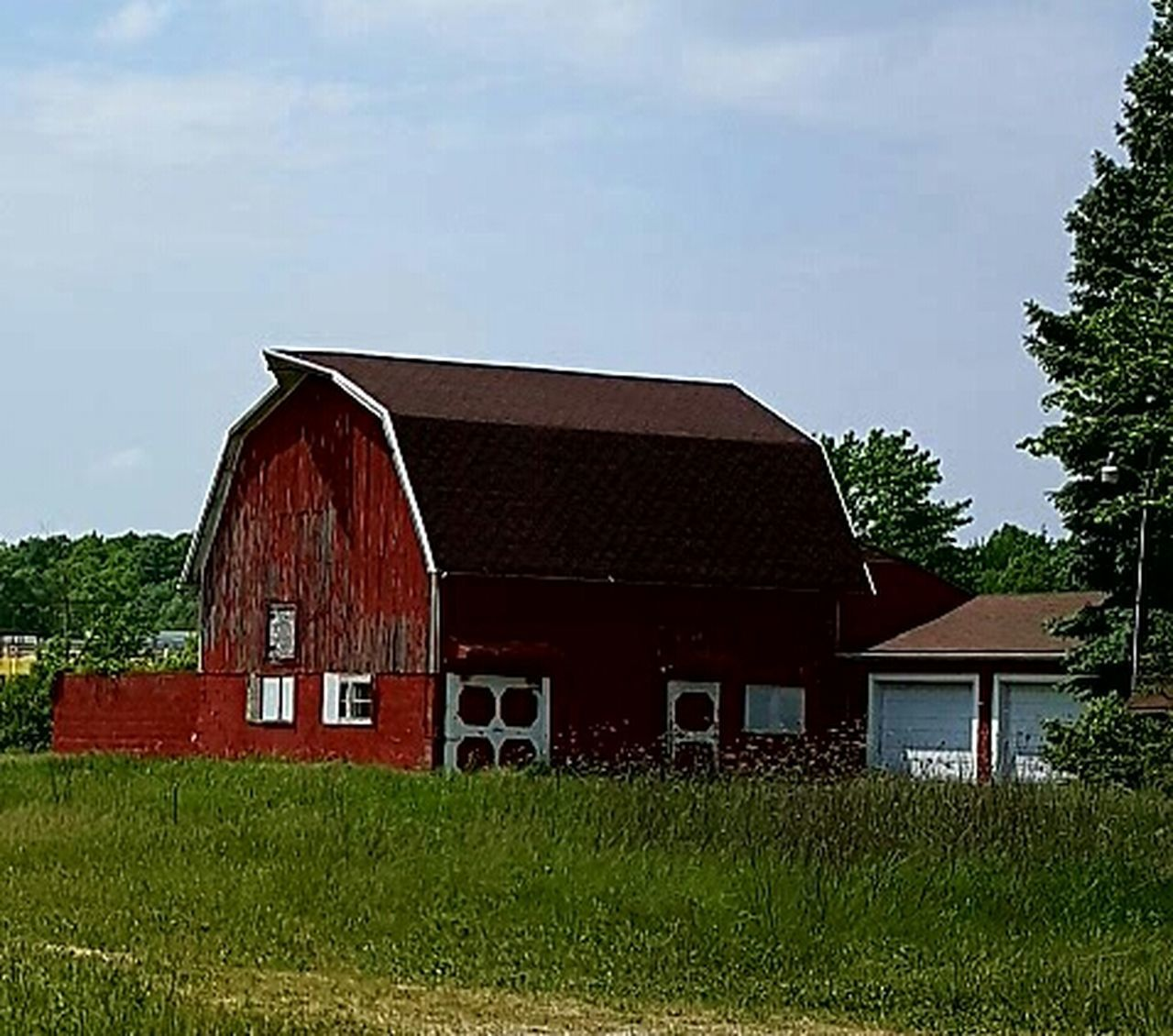 built structure, house, grass, architecture, building exterior, barn, outdoors, no people, agriculture, day, rural scene, red, tree, sky, farmhouse, nature