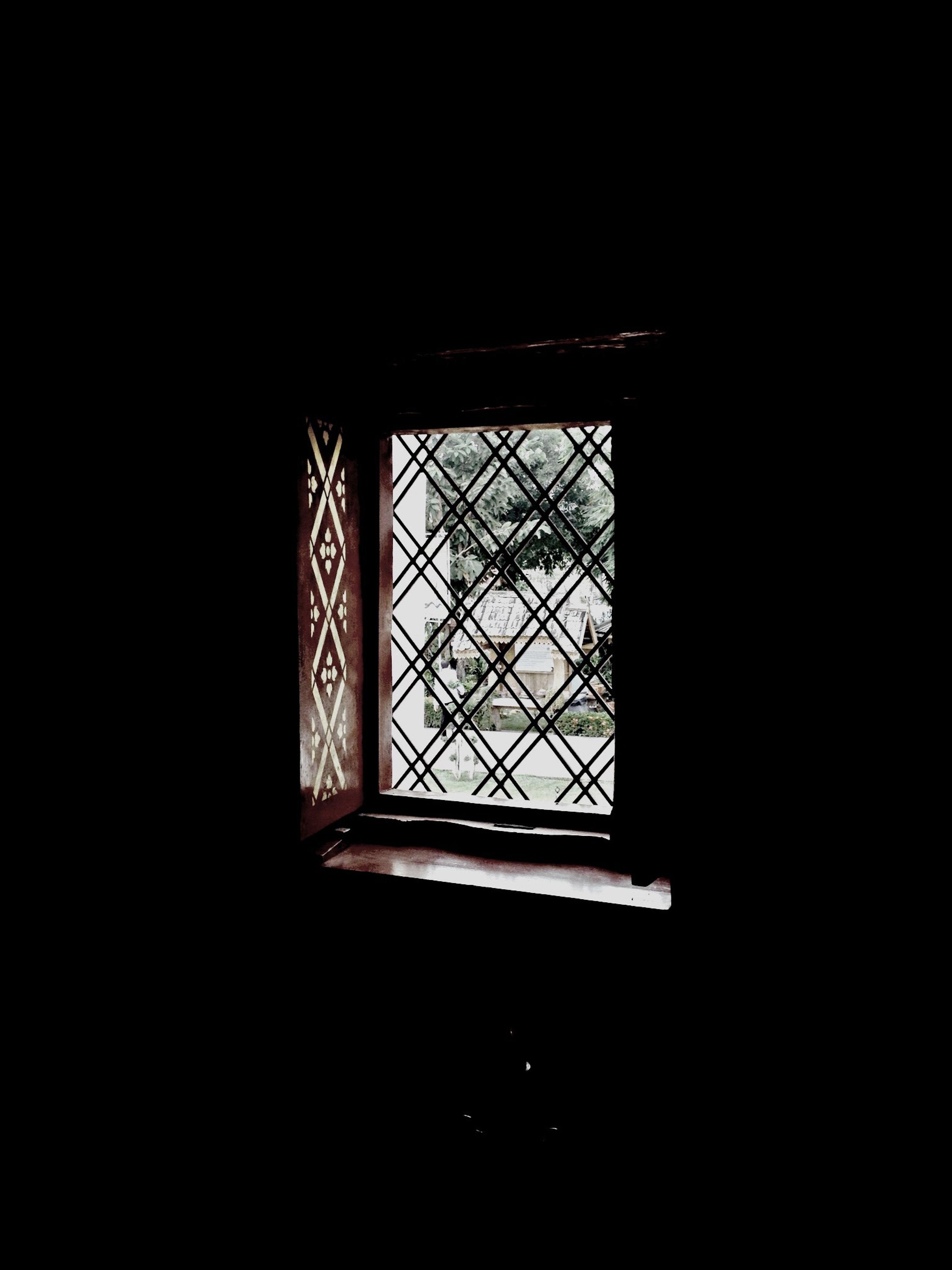 indoors, window, dark, glass - material, built structure, architecture, pattern, geometric shape, copy space, home interior, design, transparent, low angle view, no people, silhouette, house, ceiling, shape, wall - building feature, window frame