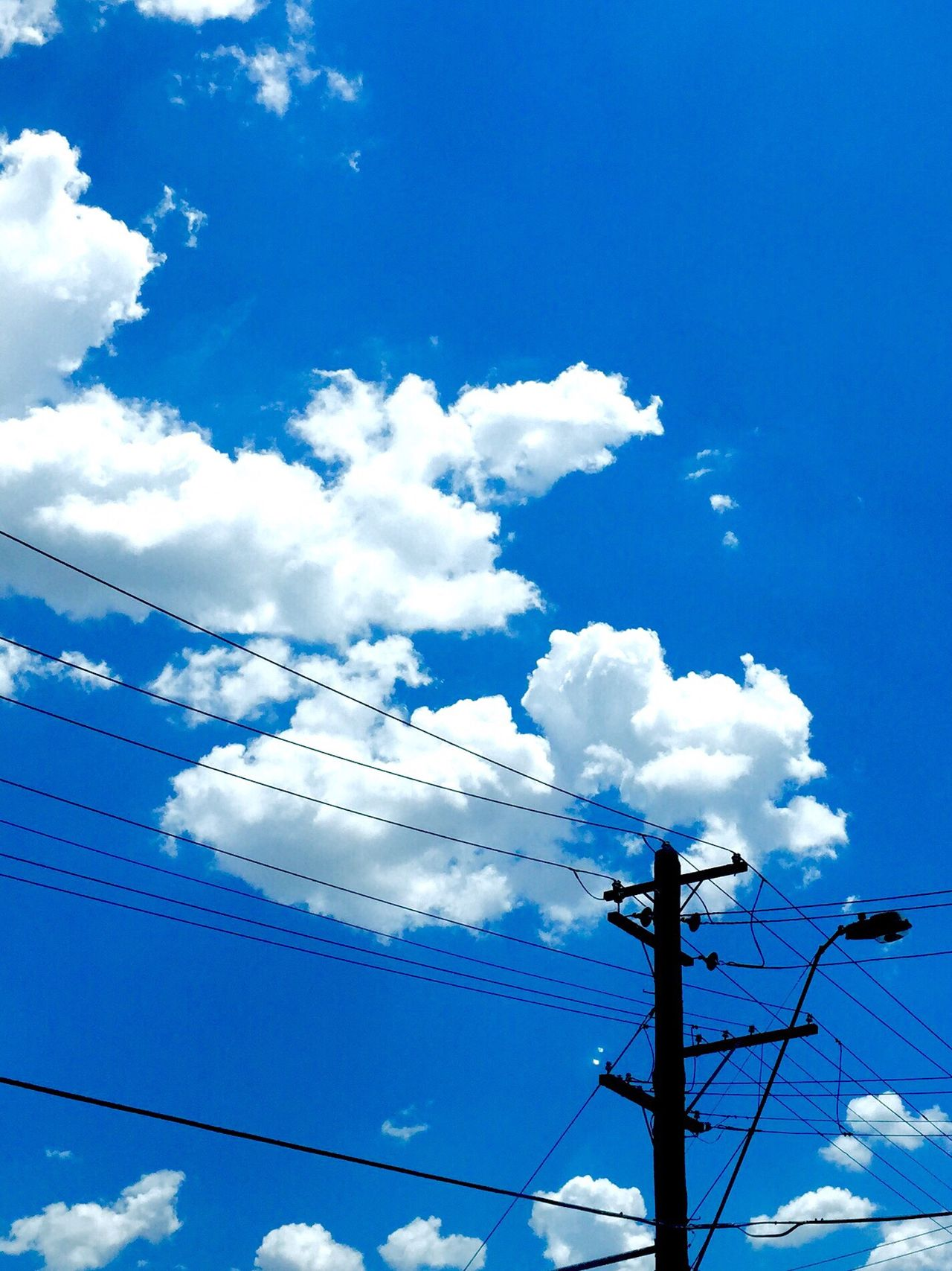 Blue Aussie skyscape with old telephone pole. LLow Angle ViewcCloud - SkysSkypPower SupplyeElectricity pPower Line cConnectioncCablefFuel And Power GenerationbBluenNo PeopleeElectricity PylontTechnologyoOutdoorsdDayNNatureeElectric PolefFirst Eyeem Photo