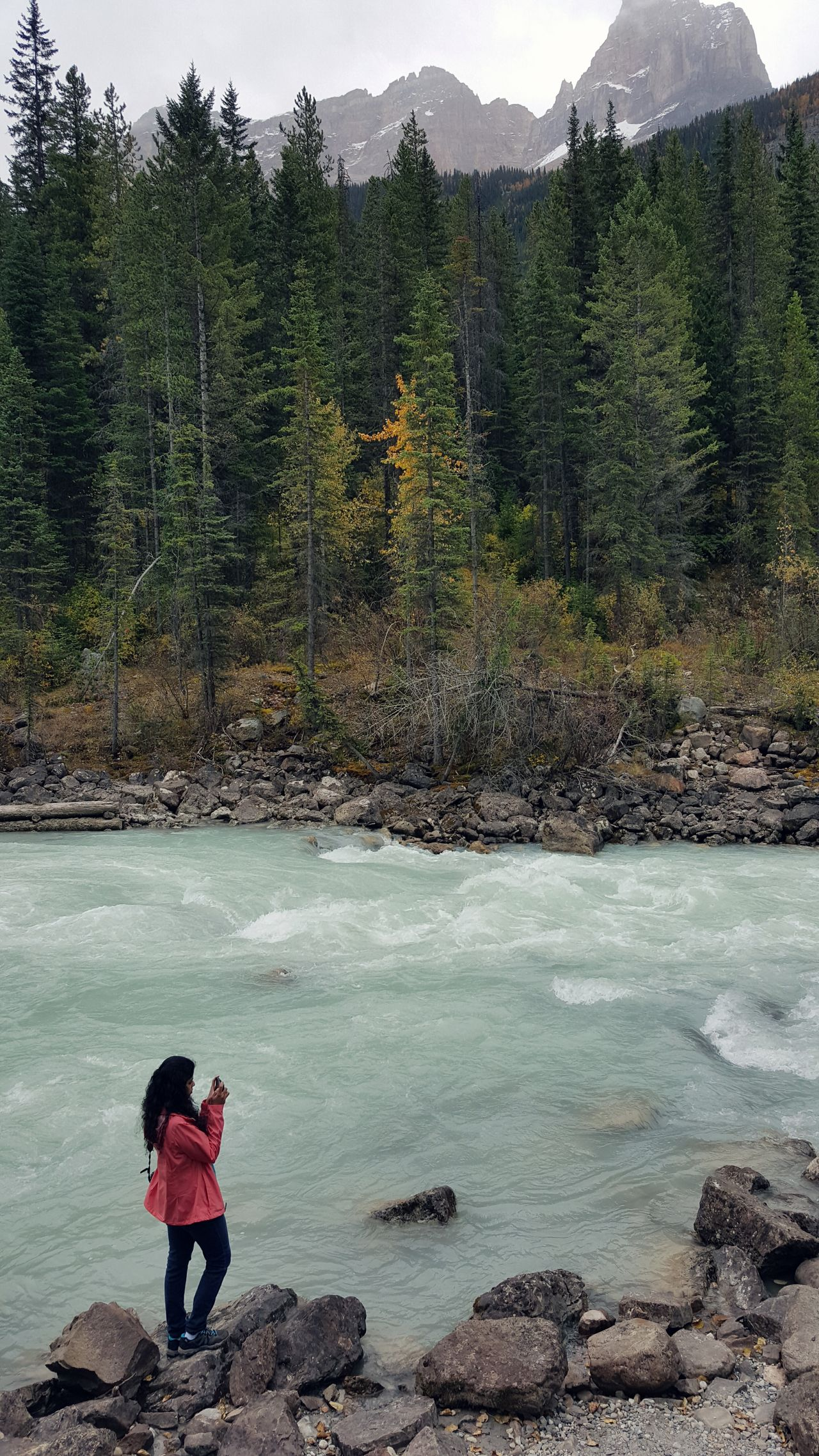Women And Nature Spring Rain Tranquility Female Female Hiker Hiking One Woman Young Female Rainy Weather Raincoat Activewear Active Lifestyle  Mountain Stream Beauty In Nature One Person Outdoors Nature Canadian Rockies