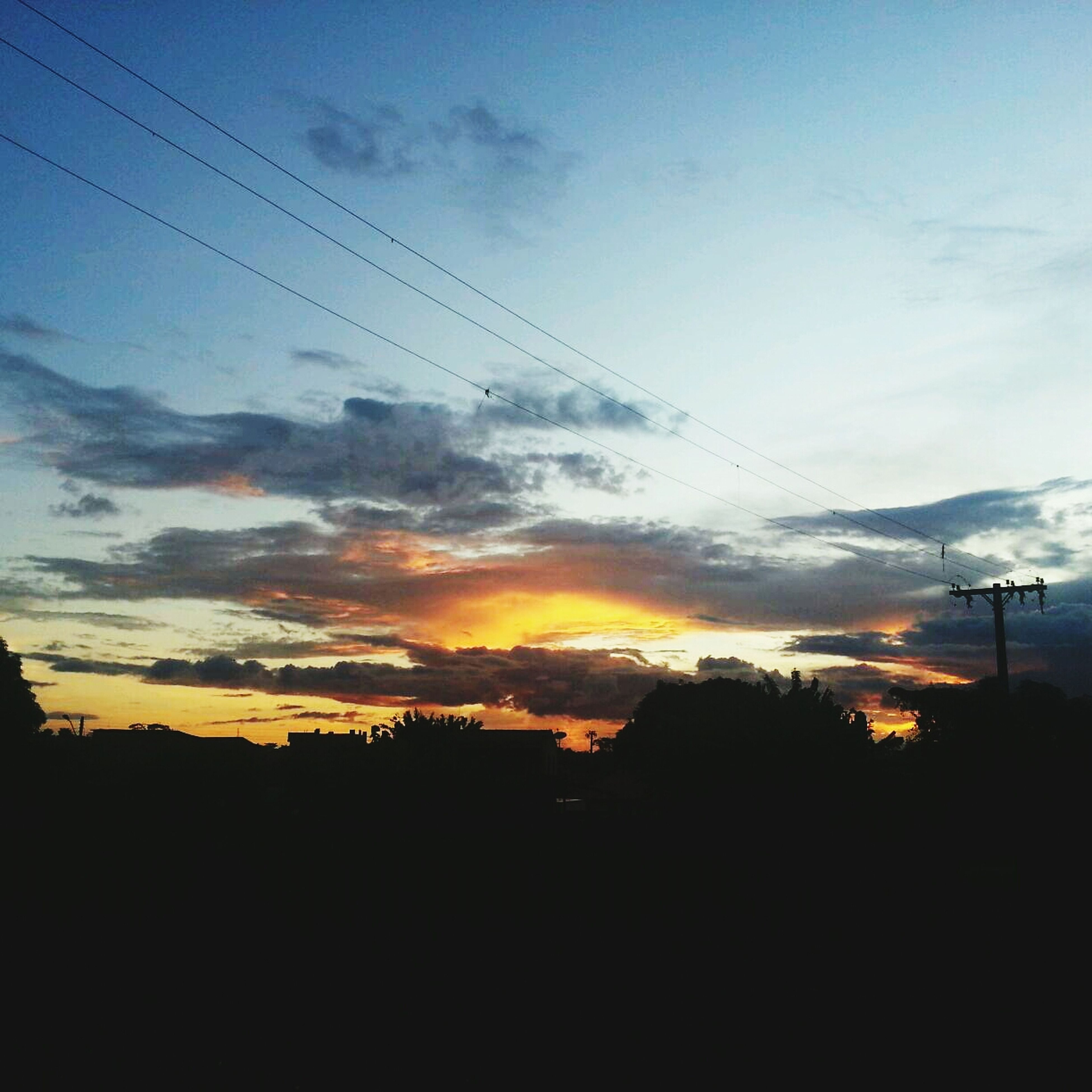 sunset, silhouette, sky, power line, electricity pylon, scenics, electricity, beauty in nature, tranquility, tranquil scene, cloud - sky, power supply, cable, tree, landscape, nature, cloud, orange color, power cable, idyllic