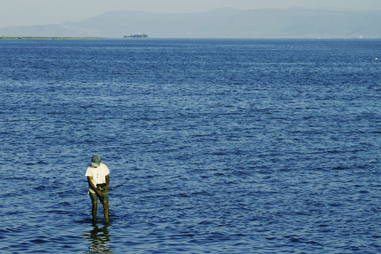 Handfishing Water Sea Tranquility Outdoors One Person Day Tranquil Scene Nature Fishing Standing Beauty In Nature Horizon Over Water Scenics People Only Men One Man Only Real People Bluesky Travel Destinations Mexico Jalisco Clear Sky Nature Chapala Tropical Climate