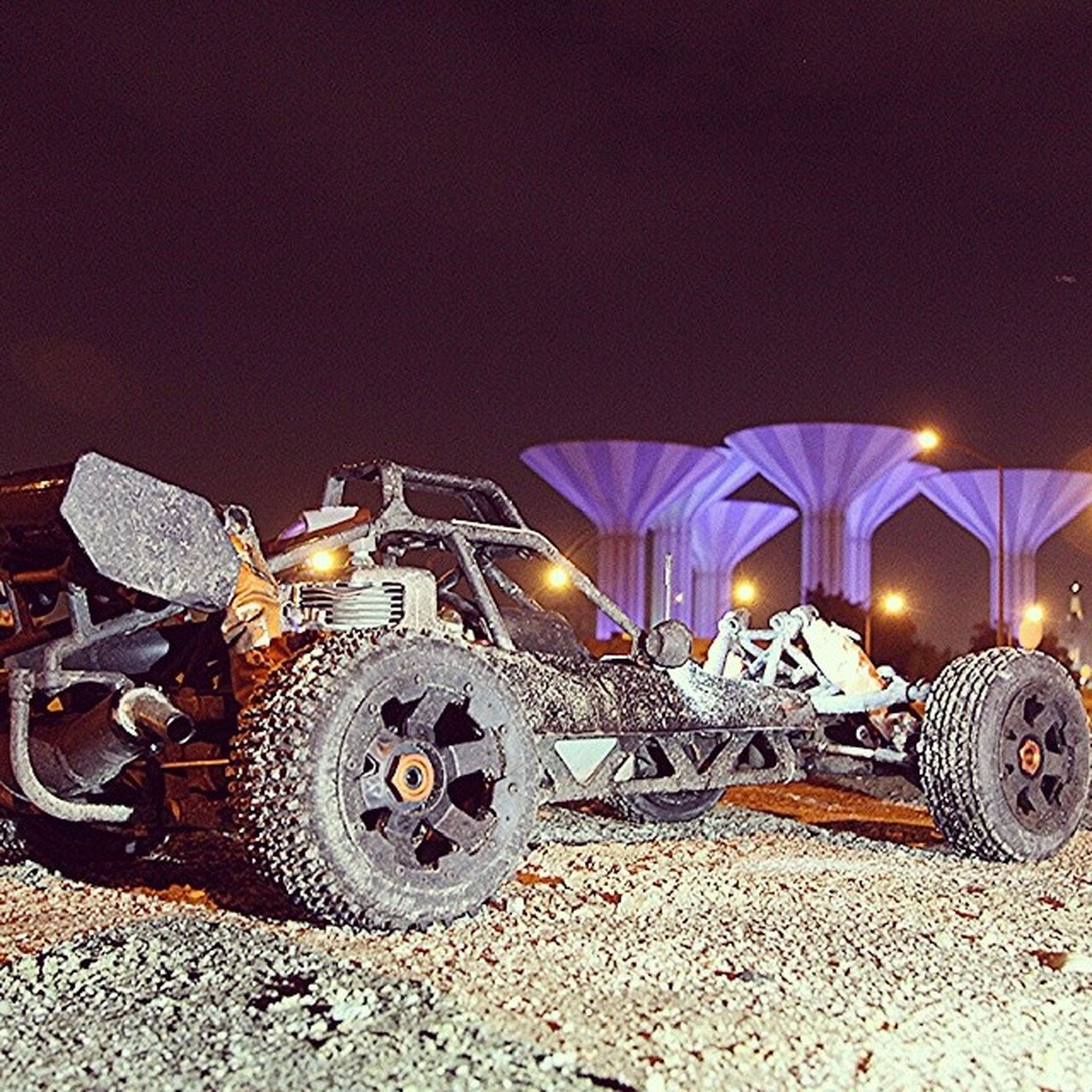 illuminated, transportation, night, land vehicle, mode of transport, stationary, parking, street, car, parked, wheel, outdoors, lighting equipment, no people, copy space, bicycle, built structure, sky, road, architecture